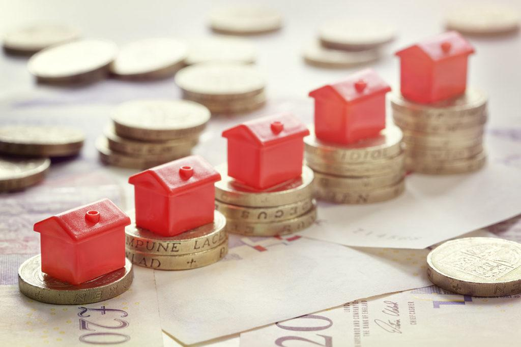 10 Ways to add value to your property - Image of coins with little monopoly houses on top
