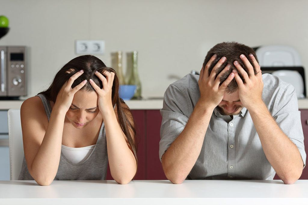 Expert advice on dealing with bad tenants - Image of two stressed individuals