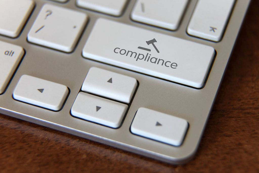 Beyond compliance – how to be a model landlord - Image of a 'compliance' key on a keyboard