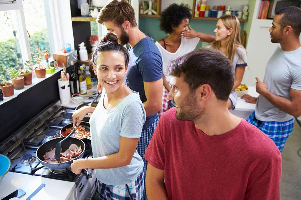 Are HMOs the way forward? - Image of people smiling in a kitchen