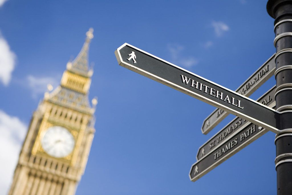 Minister spurns call for capping deposits at four weeks of rent - Image of Big Ben and a sign