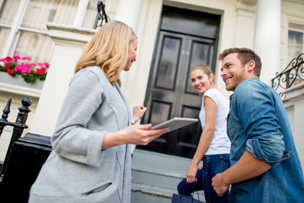 Landlord regulation - Image of a landlord showing a couple to a front door