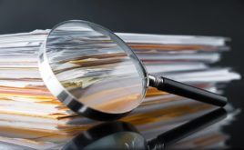 Reference or risk? You decide - Image of magnifying glass and documents