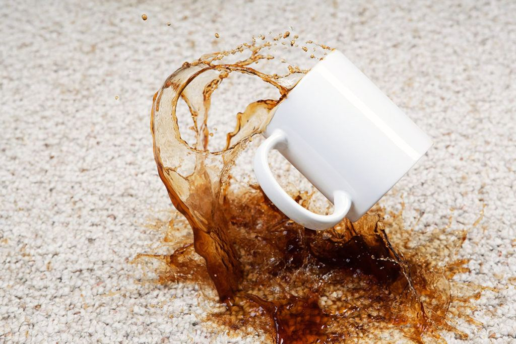 Top tips to minimise damage to your student property - Image of coffee spilt on the floor
