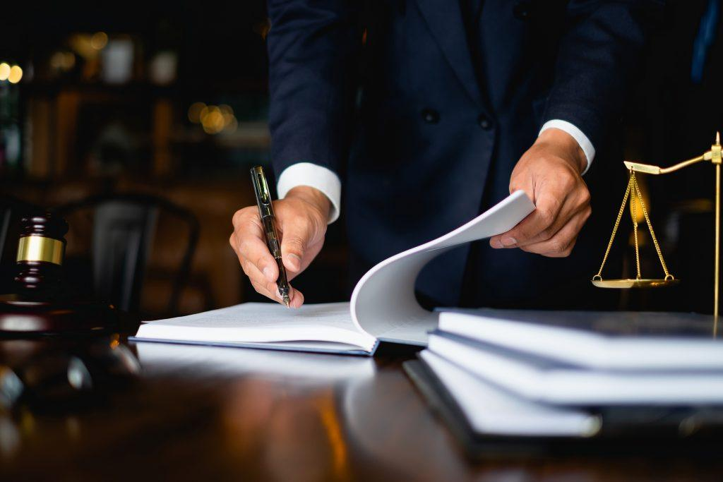 Judge tells HMRC capital gains tax guidance is wrong | Judge signing papers