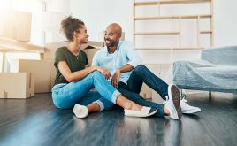 Revealed - what renters really want from a home | Young couple smiling moving into home.