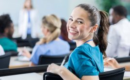 Choosing the right training course for you - Image showing student nurse smiling in a training session