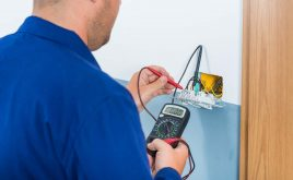 Why You Need a Landlord Electrical Safety Certificate   Electrician testing