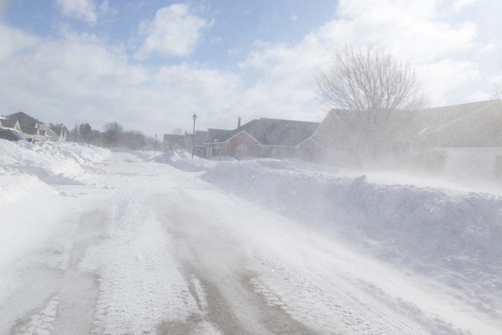 Winter guide for landlords | Road with snow storm