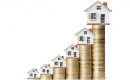 Buy to let rents rise by 2.1 per cent in a year | House on top of a pile of coins getting larger.