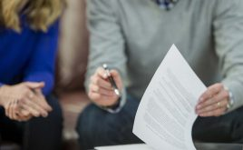 Landlords OK with longer tenancies - with conditions | Couple signing tenancy rental agreement