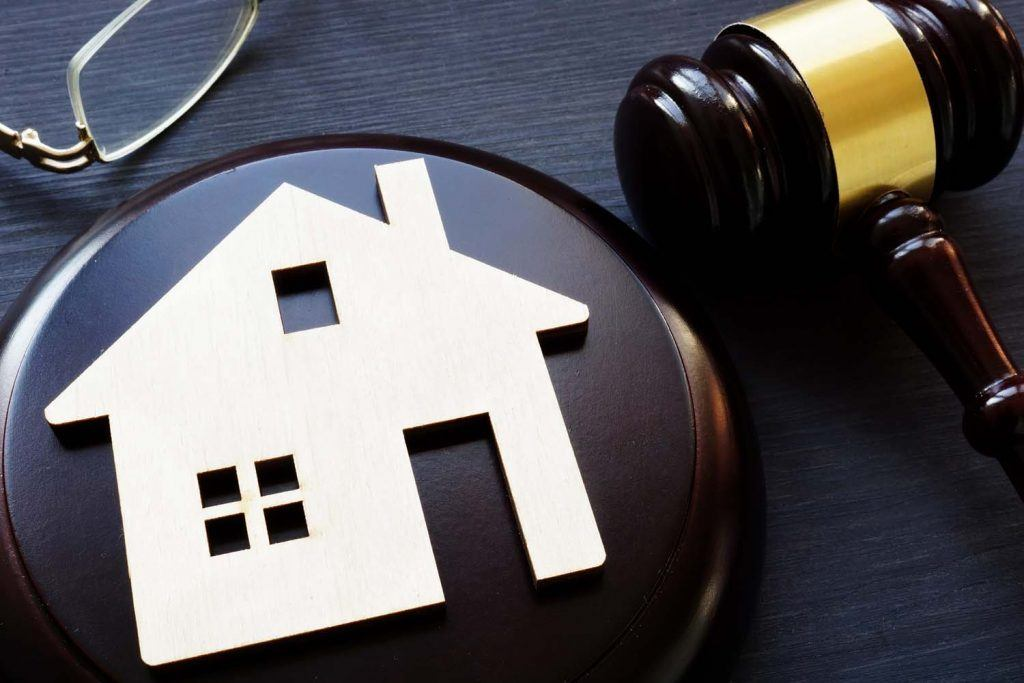 New housing court to settle landlord disputes with tenants | Model of house and gavel next to it. Property law.