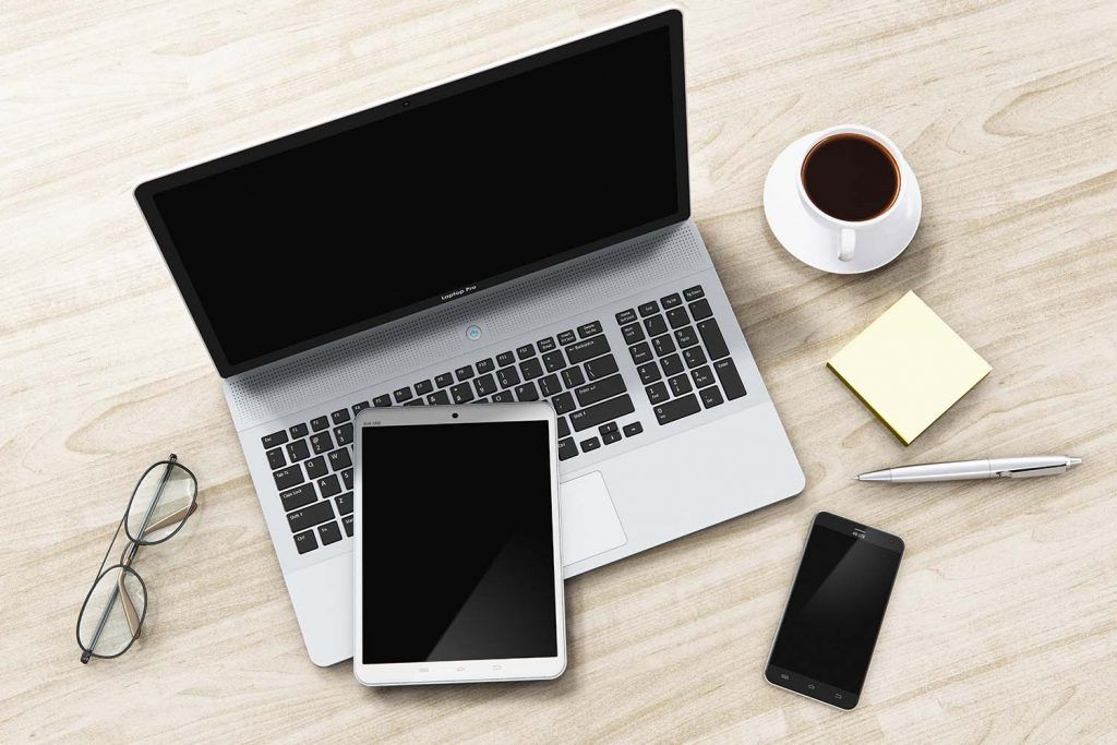 16 of the most useful apps for letting agents   Laptop, smartphone and tablet on desk