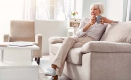 Homes for aging singles may be the future of buy to let | Elderly lady sitting on her sofa in home on her own
