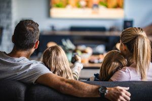15 key dates for landlords in 2019 | Family in home sitting together on the sofa