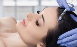How to set yourself up as an aesthetic practitioner | Woman laying down whilst receiving botox treatment