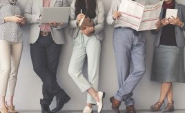 Weekly landlord news digest: 18/1/19 | Group of people reading the news on a laptop, tablet and newspaper