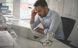 What to do if you've missed your self-assessment deadline | Man stressed out looking at computer