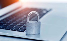 Three reasons why you are vulnerable to a cyber attack | Padlock on laptop keyboard