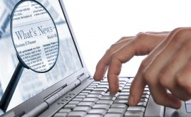 Weekly landlord news digest 22/02/19 | Man's hands are entering some words on the laptop keyboard for the news.
