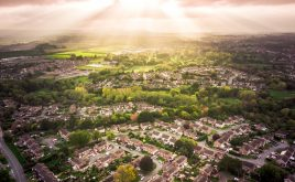 What might Brexit mean for landlords and what should you be doing to prepare? | Ariel view of houses with the sun coming through the clouds