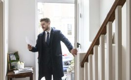 Is your property safe? How to rent a safe home | Man opening his front door arriving home