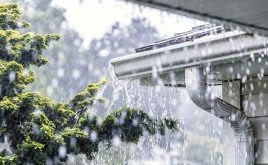 Infographic: From storms to break-ins | Torrential rain and storm falling onto guttering of house