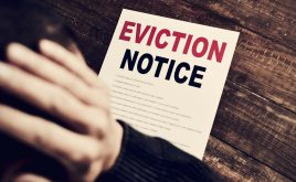 Government announce intention to abolish Section 21 | Eviction notice on wooden table