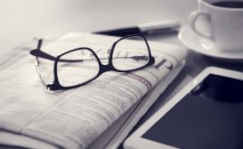 Weekly landlord news digest: Issue 12 | Newspaper with digital tablet and glasses on table