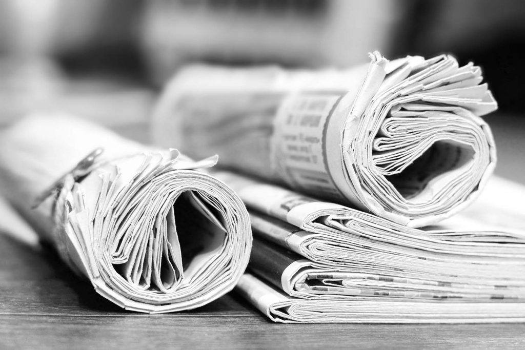Weekly landlord news digest: Issue 13 | Rolled and folded newspapers on wooden table