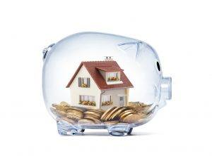 Legislation for landlords: Everything you need to know | Transparent piggy bank with model house and coins inside