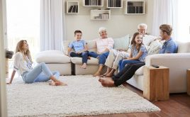 How will demographic shifts affect landlords? | Multi generation family sitting on a sofa together in a home