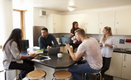 Renting rooms to students - everything you need to know | group of students in the kitchen of their shared accommodation