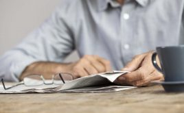 Weekly landlord news digest: Issue 16 | Man sitting at a table reading the newspaper