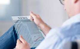Weekly landlord news digest: Issue 17 | man reading news on a digital tablet