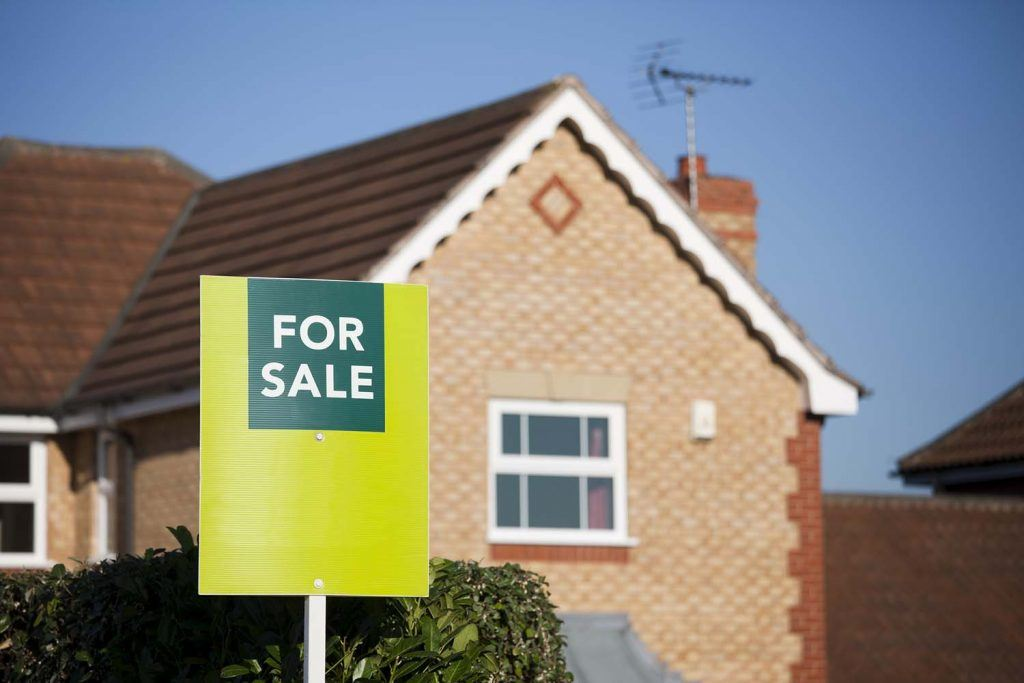 Guest blog: Local house market research essential for buy to let success | House with 'for sale' sign outside