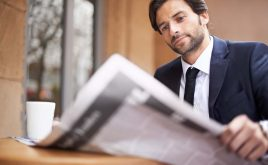 Weekly landlord news digest: Issue 21 | man reading the newspaper outside