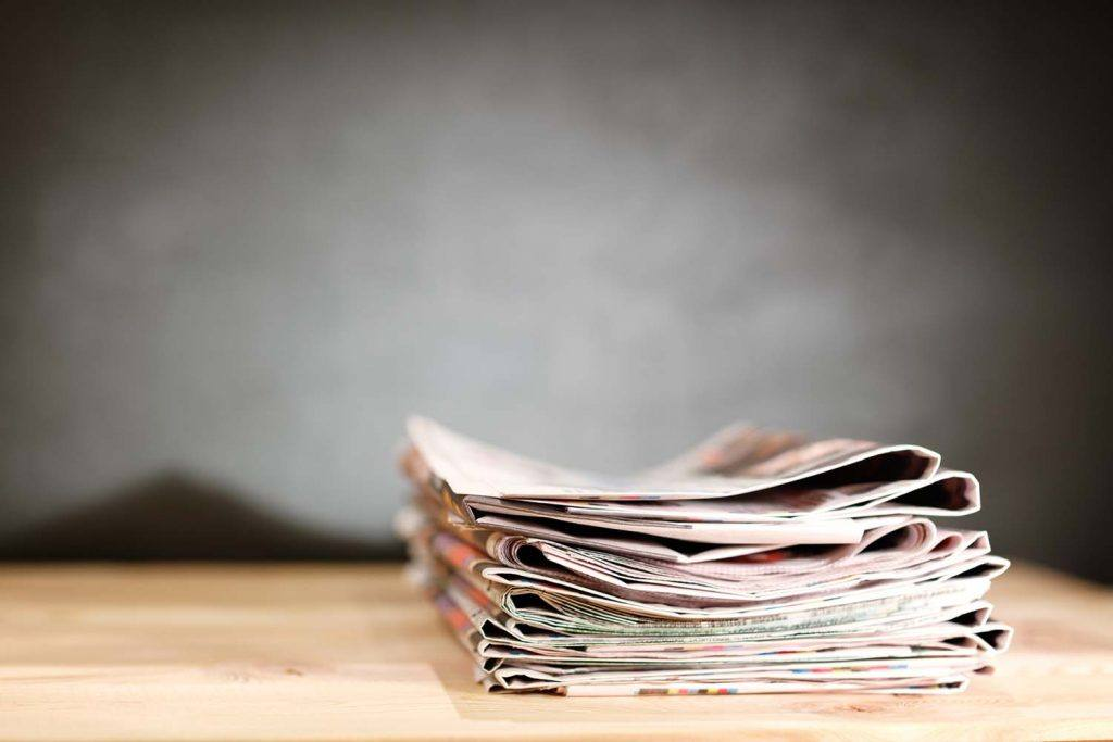 Weekly landlord news digest: Issue 24 | Stack of newspapers on wooden table