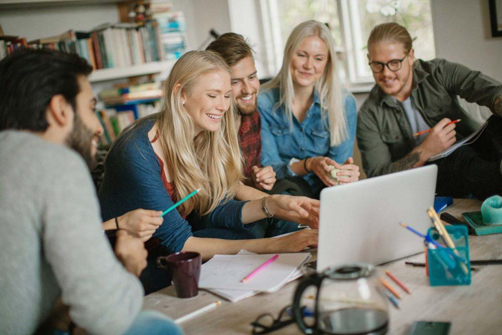 Considering renting to students? Here are 10 reasons why you should   Group of students in their rented property studying together