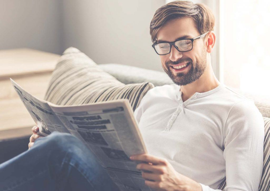 Weekly landlord news digest: Issue 26 | Man at home reading a newspaper