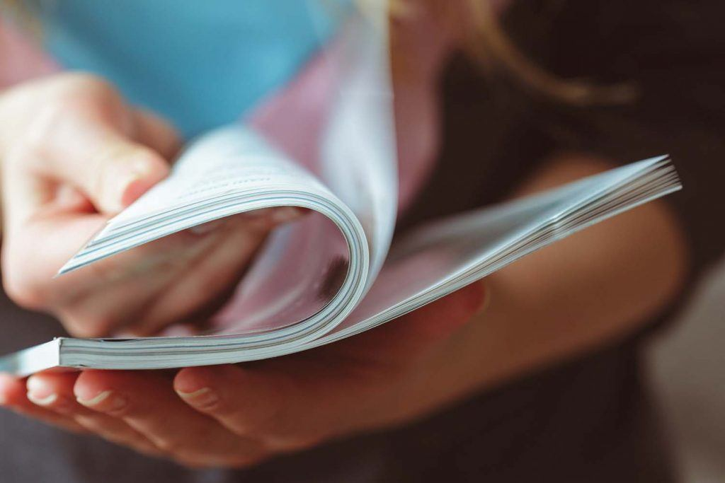 Weekly landlord news digest: Issue 30 | Woman flicking through a newspaper