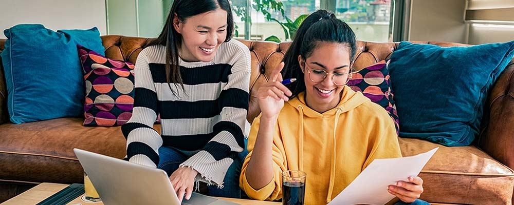 What do students really want from their landlords? | Two students in their rental accommodation laughing and studying