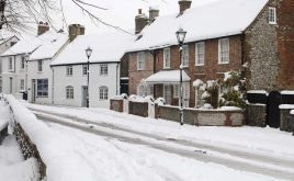 How to protect your property against snow this winter | Fresh snow covering a street and houses in Sussex, England