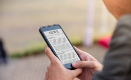 Weekly landlord news digest: Issue 35 | A man reading the news on his smart phone