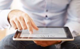 Weekly landlord news digest: Issue 34 | Man reading the news on a digital tablet