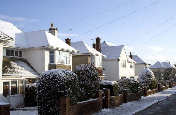 Be winter ready - everything you need to protect your property | Row of houses in winter covered in snow