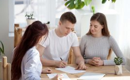 HMO tenancy agreements: what do you need to include? | Two people signing their tenancy agreement